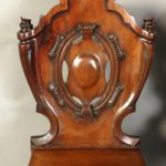 Pair of English William IV Carved Mahogany Hall Chairs