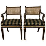 Pair of English Regency Ebonized and Gilded Armchairs